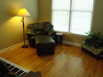 Front, private reading room with piano. Adjacent from dining room.