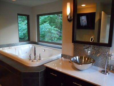Granite Countertop and Special Tile Adorn the Master Bath with Large Jetted Tub