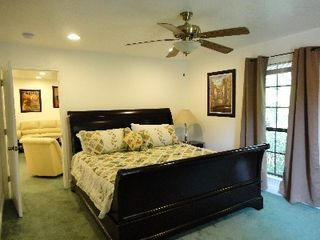 Gulfport house photo - Master King Bed room, Ceiling Fan, TV, dresser, & private Full Bath