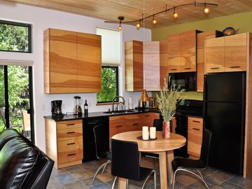 Kitchen with black granite counters and custom birch wave cabinets