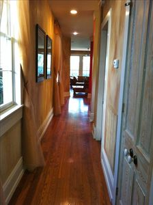 Double cedar doors, pine floors & high ceilings throughout the home & hallways