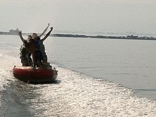 Vacation Homes in Ocean City condo photo - Tubing on Assawoman Bay, at the end of our canal