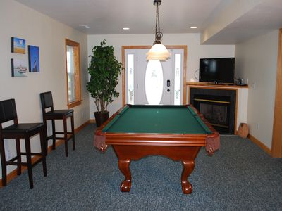 "Billiards room with 42"" flat screen TV, wet bar, microwave,and full refrig"