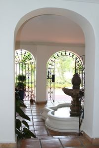 Gated entry with fountain and Spanish tiles.