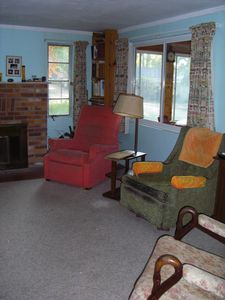Living room with windows facing the porch