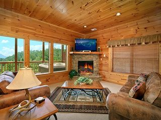 "Pigeon Forge cabin photo - Movie area w/sleeper,55"" HDTV BluRay, Surround,Wireless to stream Netflix, etc.."