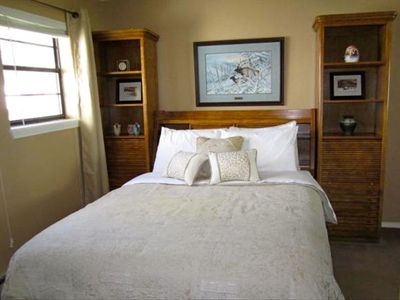 Downstairs bedroom with queen bed.  Enjoy the sounds and views of the river.