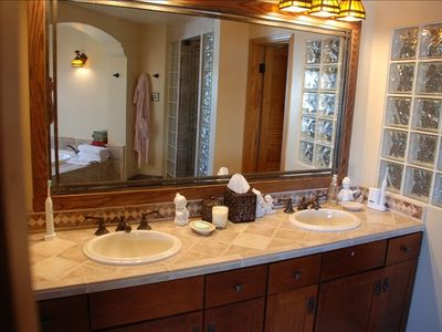 Master bath has dual vanity and steam shower.