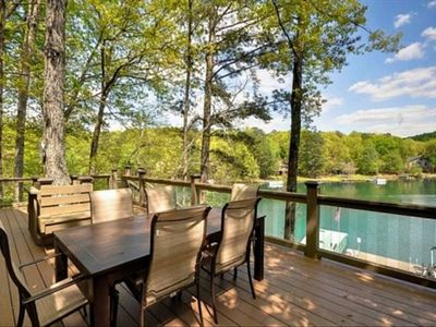 HUGE deck with glass balusters, vinyl decking, table and chairs, gas grill.