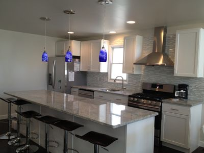 newly remodeled kitchen, all new cabinets, appliances, granite, flooring