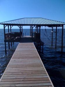 New wharf, boathouse with built-in benches, boatlift, and sun deck- built in 200
