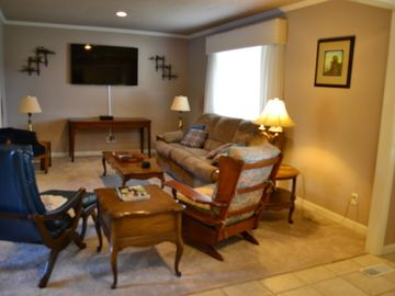 Family Room on main level with 52' flat screen TV