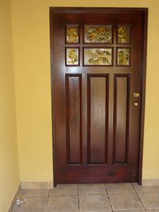 house main entrance door in Costa Rican exotic wood and stained glass