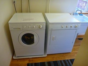 Laundry room also serves as change room/gateway to back yard and hot-tub
