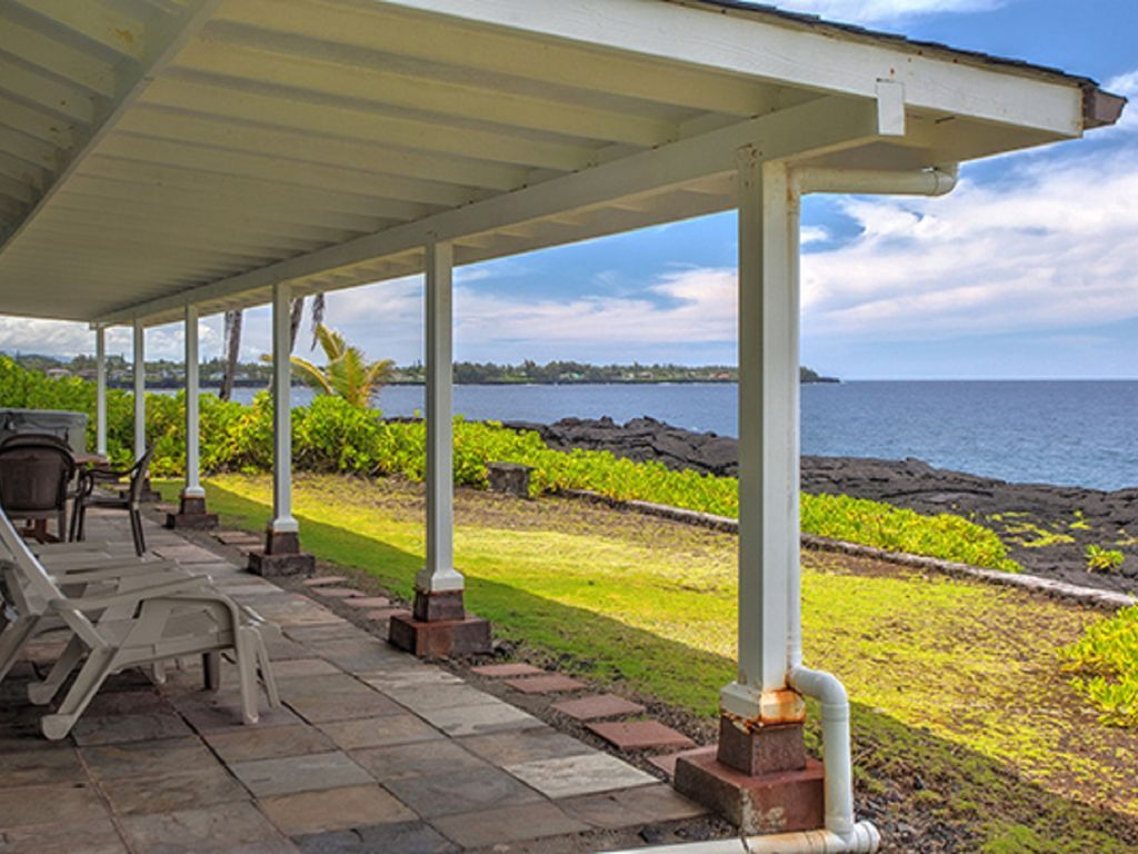 Beautiful covered lanai with view to Kaloli Point and hot tub!