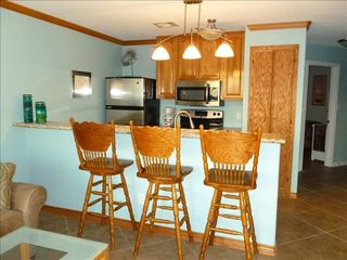 Galveston condo photo - Swival bar stools make for easy conversation