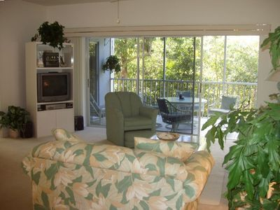 Living Room showing Lanai and nearby preserve.
