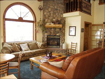 2nd Living Room features River Rock Fireplace