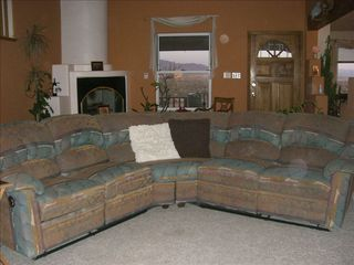 Albuquerque house photo - Living room sectional with 2 recliners and Kiva fireplace in the background