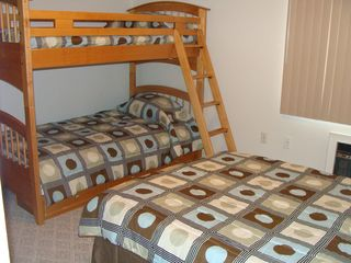 Weirs Beach condo photo - Second bedroom with bunk bed, double bed and full bath.
