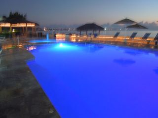 Grand Cayman condo photo - night light show at the pools