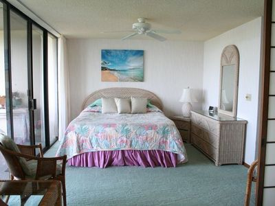 California King bed in oceanfront bedroom.
