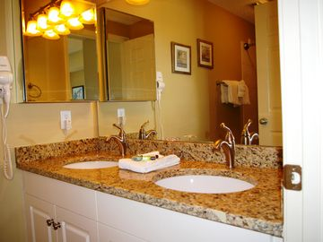 Luxurious master bath with medicine cabinet for easy access to toiletries.