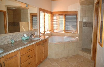 Master bath with Jacuzzi tub for two, large shower, two sinks