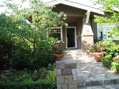 Elegant front entry with lush landscaping by Josh Chandler Designs.