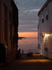 A glimpse at sunset between Toad Hall Bookstore and another shop.