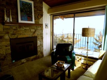 Living area with gas fireplace & walk out deck - Unit 1030