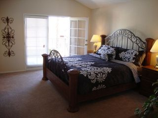 Las Vegas house photo - .master bedroom, walk in closet, ensuite. flatscreen tv, french doors to balcony