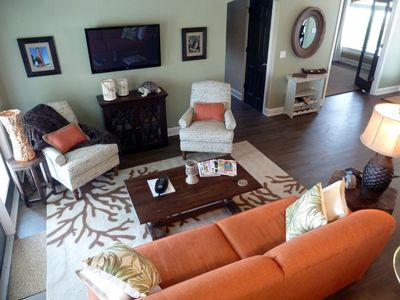 "Living Room featuring 42"" flat panel TV & views of the pool, golf pond & fairway"