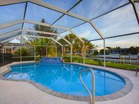 PRICES UPDATED!!  Screened Pool, Hot Tub, Tropical Garden, on Gulf-access Canal
