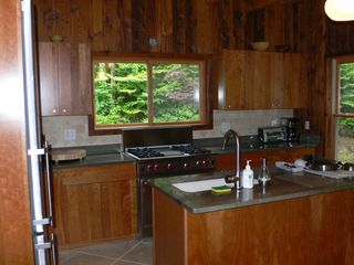 Phoenicia house photo - Kitchen with cherry cabinets, granite top and designer appliances.