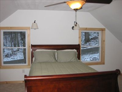Large queen bed in the master bedroom with its own bathroom with a soaking tub.