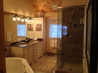 The master bathroom has a jetted oversized tub, glass enclosed shower, and more!