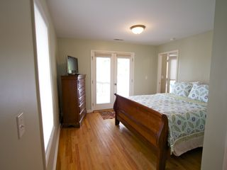 Bedroom #1 with French doors to front deck. - Folly Beach house vacation rental photo