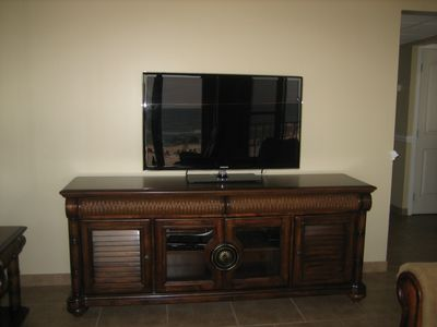 There is a 47 inch flat screen with a blu-ray DVD player in the den.