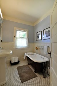 Beautiful upstairs guest bathroom with toiletries
