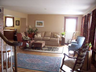 The spacious living room is open to flow between kitchen & dining room.