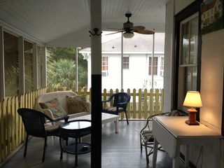 Tybee Island cottage photo - Upstairs screened porch shaded by 5 palm trees.
