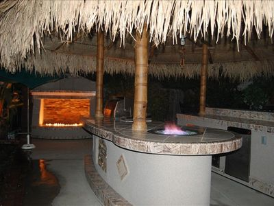 Huge 18 foot round Palapa covering outdoor BBQ and Bar - next 2 outdoor firewall
