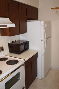 Galley style kitchen...oven/stove, microwave, and refrigerator.
