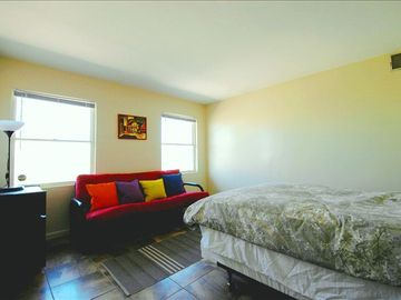 Middle bedroom with queen bed and futon