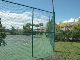 Celebration condo photo - Tennis Court behind Club House