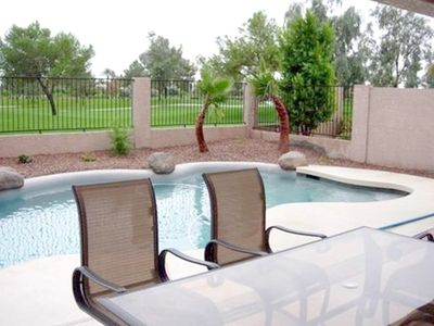 BBQ and Dining outside by the pool with view of Ocotillo Golf