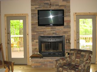 Beaver Lake house photo - Fireplace and flat screen satilitte smart TV. Doors to rear deck.