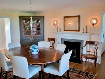 Formal Dining Room With Fireplace