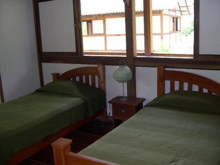 Montezuma bungalow photo - These beds can easily be pushed together to make a double bed.